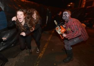 Haunted house goers get frightened.