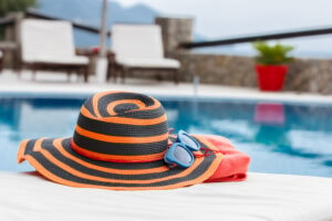 beach hat with sunglasses by the pool